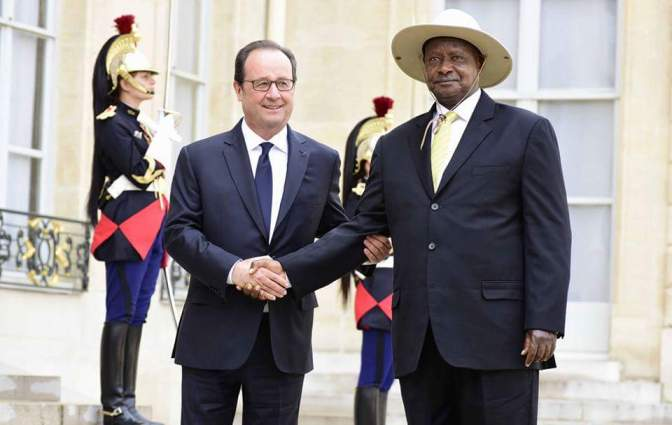 President Museveni Meets President Hollande In Paris