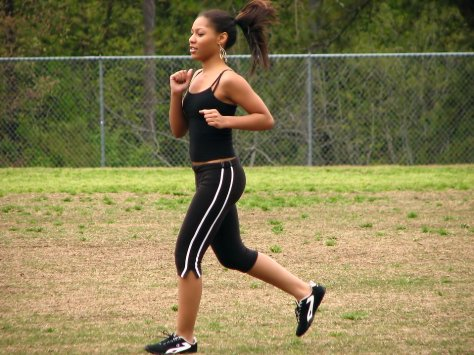 jogging-a-beautiful-teen-african-american-girl-running-by-a-fence-pv
