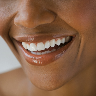 Close up of African American woman smiling